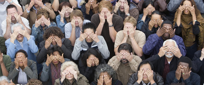 crowd of people covering eyes